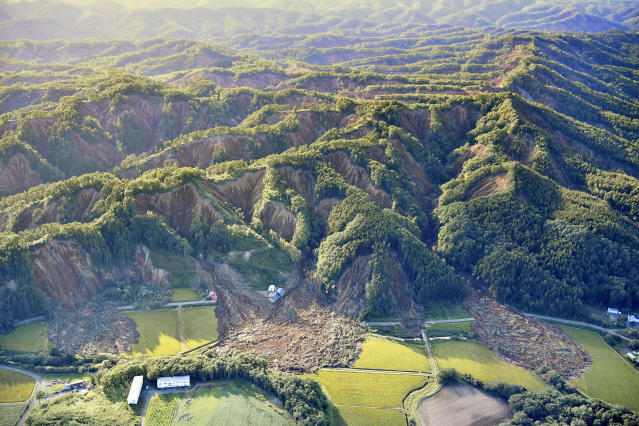 <p>Landslides are seen in Atsuma, Hokkaido, northern Japan Thursday, September 6, 2018. Rescuers were rushing to unearth survivors and restore power Thursday after a powerful earthquake jolted Japan's northernmost main island of Hokkaido, buckling roads, knocking homes off their foundations and causing entire hillsides to collapse. (Tsuyoshi Ueda/Kyodo News via AP) </p>