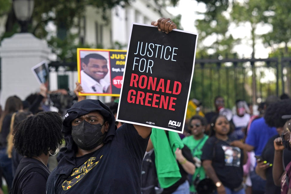 Demonstrators stand in front of the governor's mansion after a march from the state Capitol in Baton Rouge, La., Thursday, May 27, 2021, protesting the death of Ronald Greene, who died in the custody of Louisiana State Police in 2019. (AP Photo/Gerald Herbert)