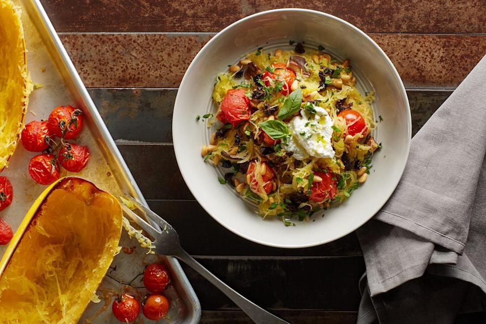 """Rather than pasta, serve the salty and spicy flavors of this classic Southern Italian dish with spaghetti squash """"noodles"""" for a delicious, hearty vegetarian dinner. <a href=""""https://www.epicurious.com/recipes/food/views/sheet-pan-spaghetti-squash-puttanesca-56390005?mbid=synd_yahoo_rss"""" rel=""""nofollow noopener"""" target=""""_blank"""" data-ylk=""""slk:See recipe."""" class=""""link rapid-noclick-resp"""">See recipe.</a>"""