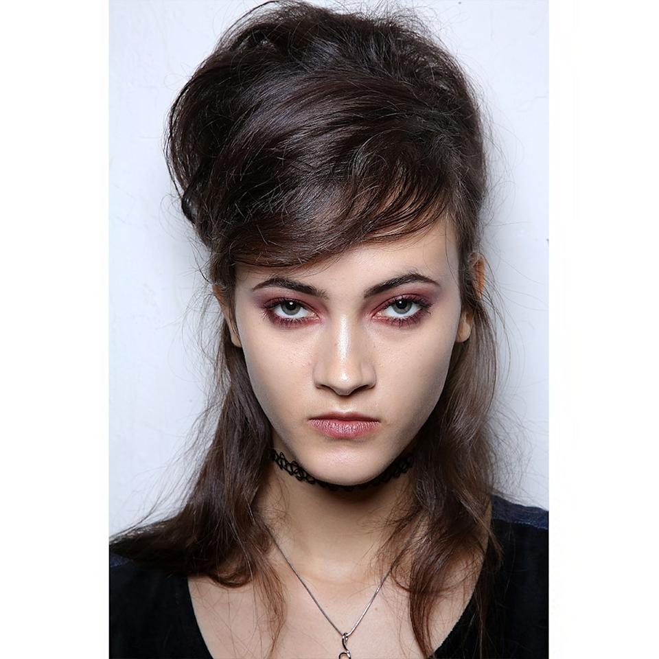 <p>The '60s were in full swing at Anna Sui, where the bouffant made a big comeback. Months later, we're still buzzing about the over-the-top, half-up/half-down, Brigitte Bardot-esque beehives.</p>