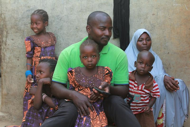 Hauwa's father Musa Maina insists he has not given up hope (AFP Photo/Audu Ali MARTE)