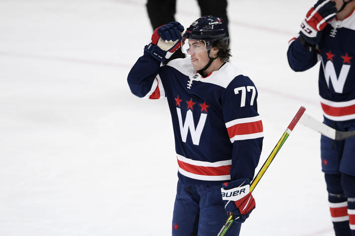 Washington Capitals right wing T.J. Oshie (77) celebrates his goal during the second period of an NHL hockey game against the New Jersey Devils, Sunday, Feb. 21, 2021, in Washington. (AP Photo/Nick Wass)