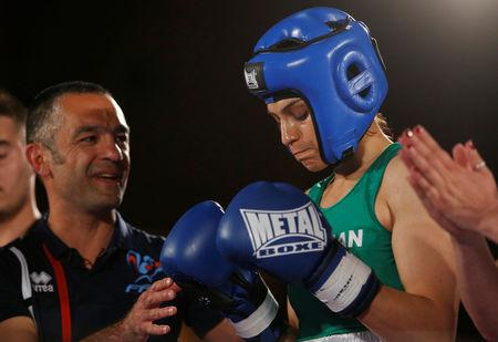 FILE PHOTO: Iranian boxer Sadaf Khadem and coach Mahyar Monshipour react before the fight against French boxer Anne Chauvin during an official boxing bout in Royan, France, April 13, 2019. REUTERS/Stephane Mahe
