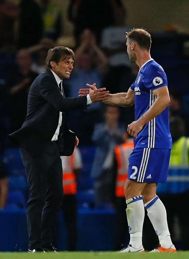 Chelsea's head coach Antonio Conte (L) celebrates with Chelsea's defender Branislav Ivanovic on the pitch after the English Premier League football match between Chelsea and West Ham United at Stamford Bridge in London on August 15, 2016 (AFP Photo/Ian Kington)
