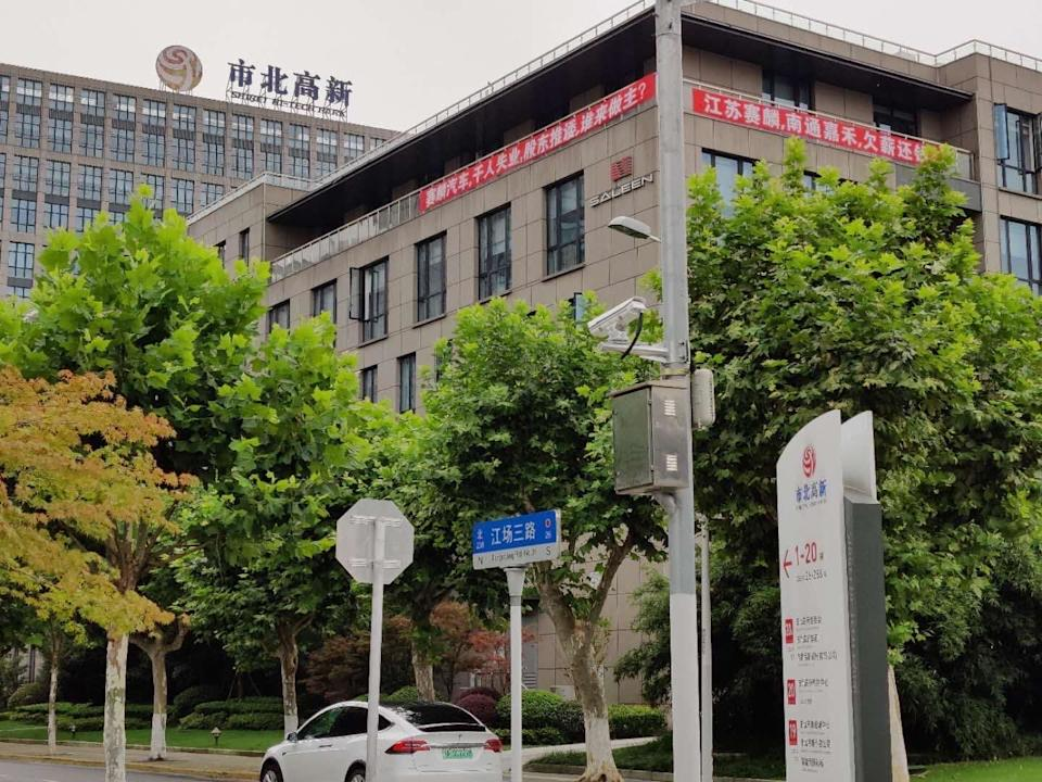 """At Jiangsu Saleen's offices in Shanghai, employees posted a banner demanding salaries owed since the company shut down. <span class=""""copyright"""">(Saleen Automotive Inc.)</span>"""