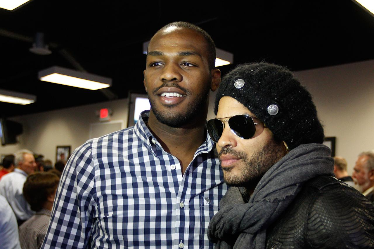 DAYTONA BEACH, FL - FEBRUARY 26:  UFC fighter Jon Jones poses with musician Lenny Kravitz during the driver's meeting prior to the start of the NASCAR Sprint Cup Series Daytona 500 at Daytona International Speedway on February 26, 2012 in Daytona Beach, Florida.  (Photo by Chris Graythen/Getty Images)