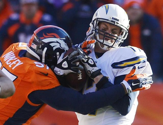 San Diego Chargers quarterback Philip Rivers (17) is sacked by Denver Broncos defensive end Jeremy Mincey (57) in the first quarter of an NFL AFC division playoff football game, Sunday, Jan. 12, 2014, in Denver. (AP Photo/Jack Dempsey)
