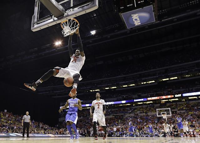 Louisville's Montrezl Harrell dunks during the first half of an NCAA Midwest Regional semifinal college basketball tournament game against the Kentucky Friday, March 28, 2014, in Indianapolis. (AP Photo/David J. Phillip)