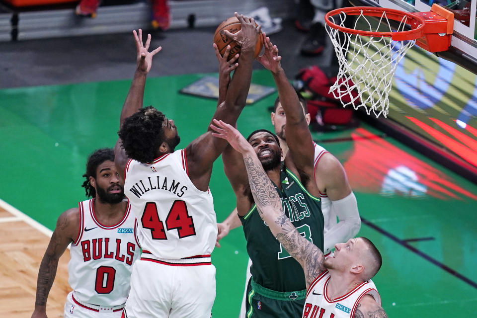 Chicago Bulls forward Patrick Williams, left, battles for a rebound against Boston Celtics center Tristan Thompson, right, during the first half of an NBA basketball game, Monday, April 19, 2021, in Boston. (AP Photo/Charles Krupa)