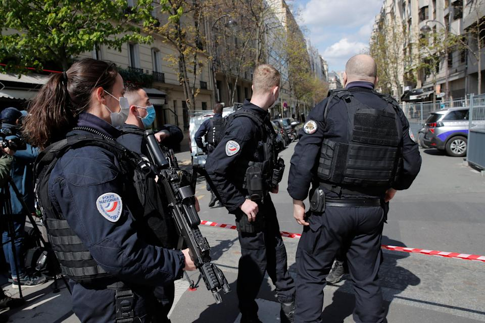 <p>Police officers cordon off the area after a shooting </p> (AP)