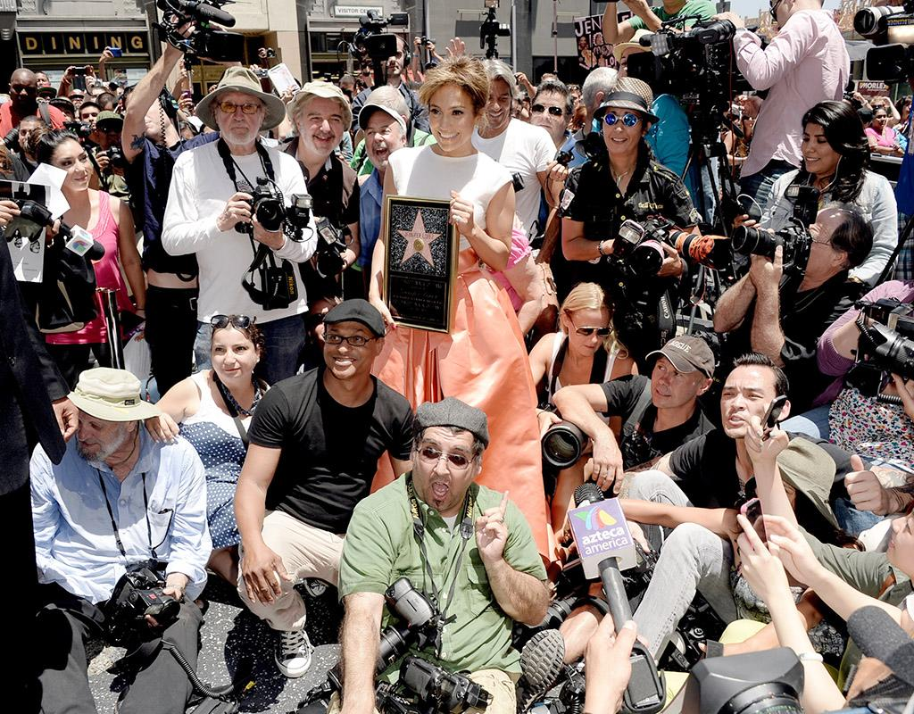 Celebs are often dodging the paparazzi, but Jennifer Lopez embraced tehir attention on Thursday, when she was honored with the 2,500th star on the Hollywood Walk of Fame on Thursday. (6/20/2013)