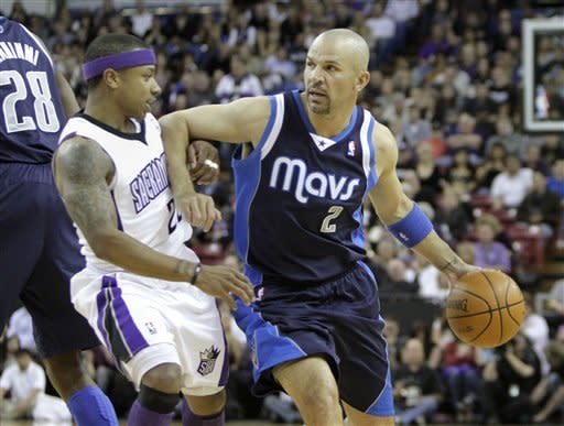 Dallas Mavericks guard Jason Kidd, right, drives against Sacramento Kings guard Isaiah Thomas during the first quarter of an NBA basketball game in Sacramento, Calif., Friday, March 9, 2012. (AP Photo/Rich Pedroncelli)