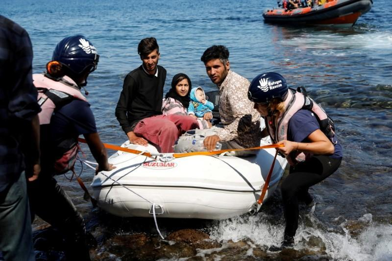 FILE PHOTO: A small inflatable boat carrying migrants from Afghanistan is towed by rescuers of the Refugee Rescue NGO, near Skala Sikamias, on the island of Lesbos