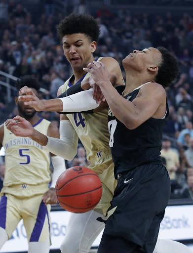 Washington's Matisse Thybulle, left, fouls Colorado's Shane Gatling during the first half of an NCAA college basketball game in the semifinals of the Pac-12 men's tournament Friday, March 15, 2019, in Las Vegas. (AP Photo/John Locher)