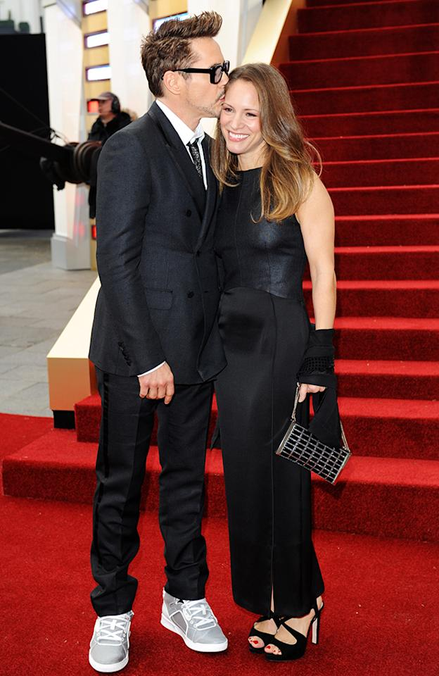 Susan Downey and Robert Downey Jr attend a special screening of 'Iron Man 3' at The Odeon Leicester Square on April 18, 2013 in London, England.