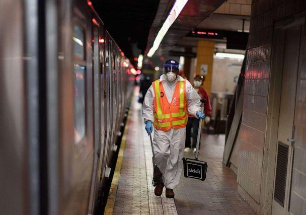 PHOTO: A MTA worker cleans subway trains at a station, May 7, 2020, in New York City. (Angela Weiss/AFP via Getty Images)