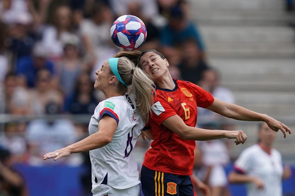 United States' midfielder Julie Ertz (L) vies with Spain's midfielder Vicky Losada during the France 2019 Women's World Cup round of sixteen football match between Spain and USA, on June 24, 2019, at the Auguste-Delaune stadium in Reims, northern France. (Photo by Lionel BONAVENTURE / AFP) (Photo credit should read LIONEL BONAVENTURE/AFP/Getty Images)
