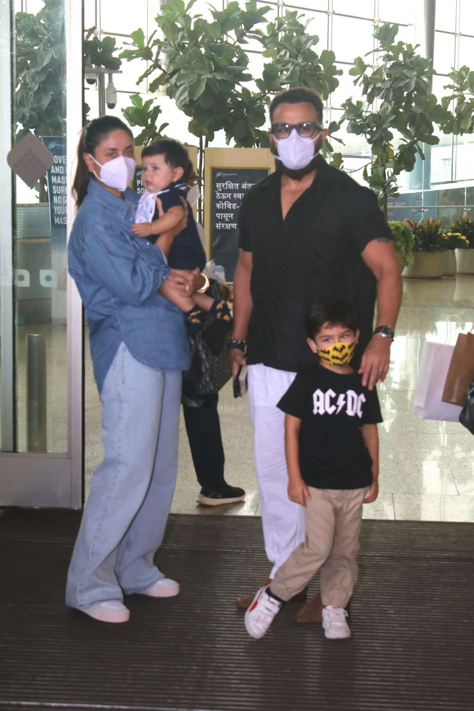 """<div class=""""paragraphs""""><p>Saif Ali Khan and Taimur stand beside Kareena Kapoor who is holding baby Jeh.</p></div>"""