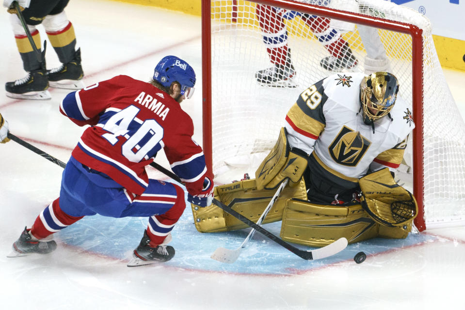 Vegas Golden Knights' Marc-Andre Fleury makes a save on Montreal Canadiens' Joel Armia during the second period of Game 3 of an NHL hockey semifinal series, Friday, June 18, 2021, in Montreal. (Paul Chiasson/The Canadian Press via AP)