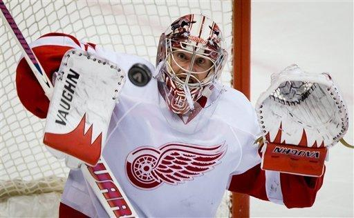 Detroit Red Wings goalie Jimmy Howard watches the puck against the Vancouver Canucks during the third period of an NHL hockey game, Saturday, March 16, 2013,in Vancouver, British Columbia. (AP Photo/The Canadian Press, Darryl Dyck)