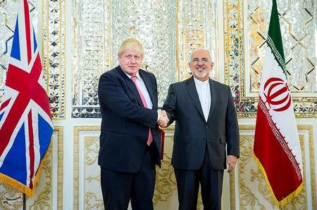 Iran's Foreign Minister Mohammad Javad Zarif shakes hands with Britain's Foreign Secretary Boris Johnson during their meeting in Tehran