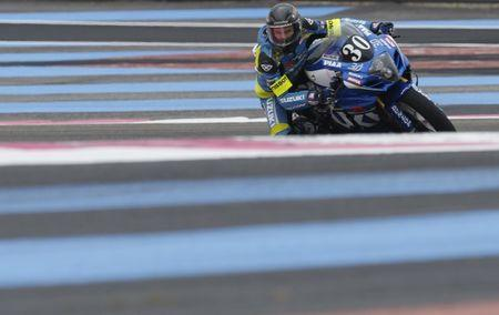 French rider Delhalle on Suzuki takes a curve during free practice for the Bol d'Or motorcycle endurance race at the Paul Ricard circuit in Le Castellet