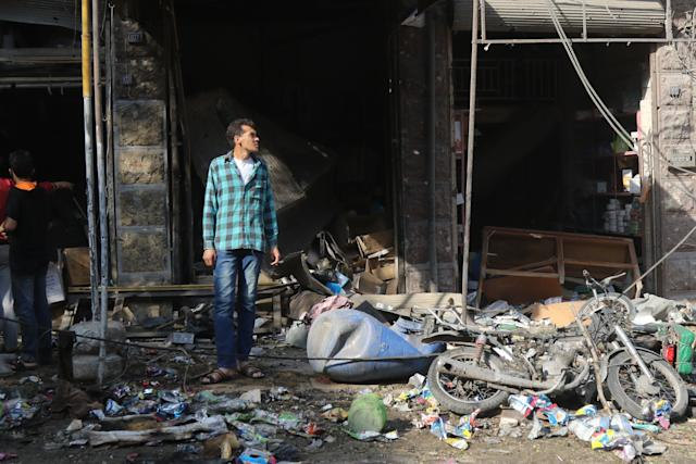 A Syrian resident looks at the damage following a reported airstrike on a vegetable market in Maaret al-Numan in Syria's northern province of Idlib, Oct. 8, 2017.