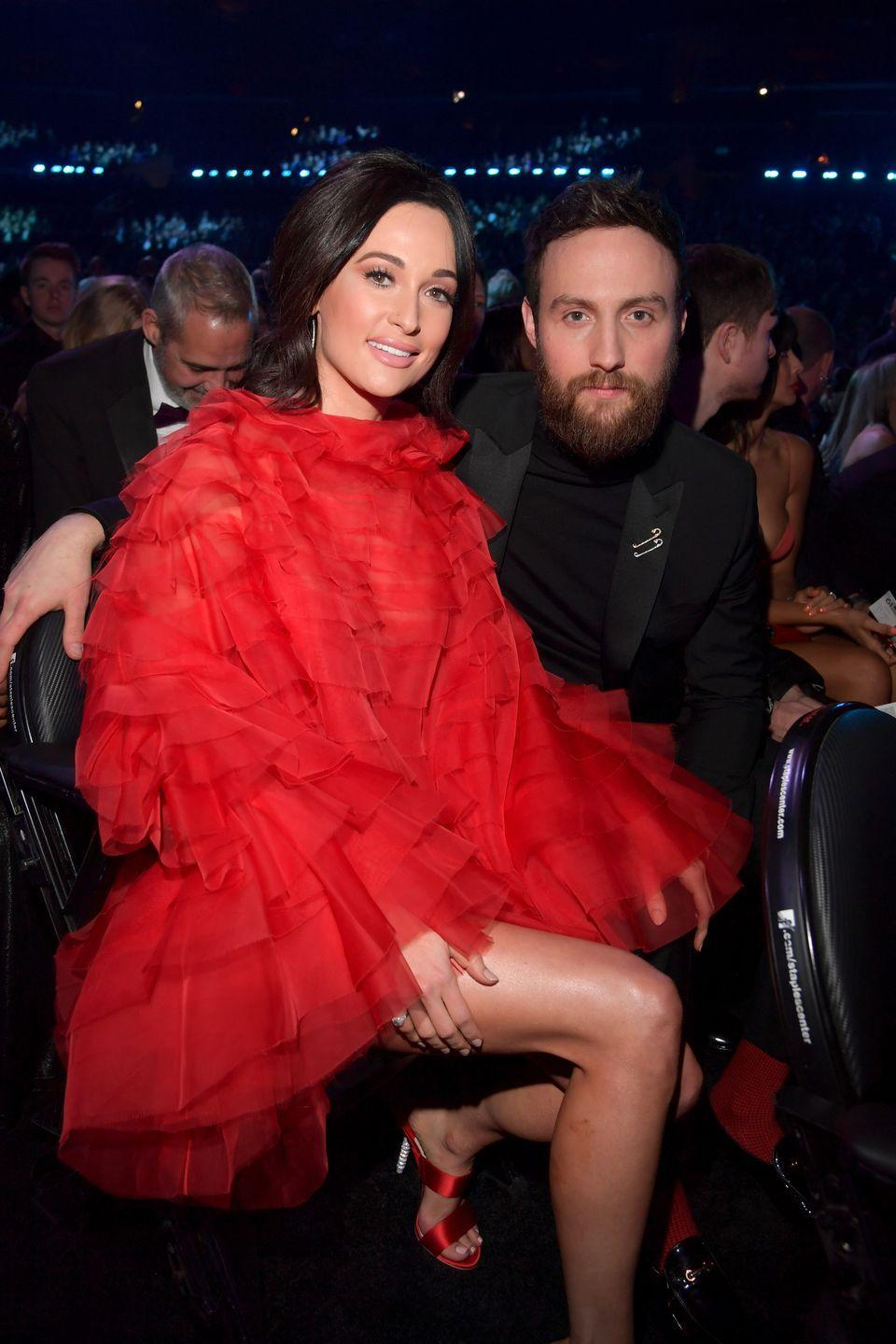 """<p>Kacey Musgraves and Ruston Kelly's cosmic connection was sparked at a songwriter's showcase in 2016 when Kacey gave Ruston her number so they could write together. Two years later, Ruston and Kacey tied the knot, but ran into trouble sometime this summer. They announced their split in July. </p><p>""""Though we are parting ways in marriage, we will remain true friends for the rest of our lives. We hold no blame, anger, or contempt for each other and we ask for privacy and positive wishes for us both as we learn how to navigate through this,"""" they wrote in a statement to <em><a href=""""https://people.com/country/kacey-musgraves-ruston-kelly-split-everything-theyve-said-about-relationship/"""" rel=""""nofollow noopener"""" target=""""_blank"""" data-ylk=""""slk:People"""" class=""""link rapid-noclick-resp"""">People</a></em>.</p>"""