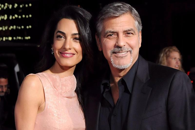 Generous: Power couple Amal and George Clooney are said to have given neighbours tens of thousands of pounds in compensation after noise caused by home renovation