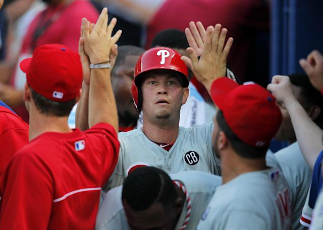 Philadelphia Phillies Reid Brignac (17) celebrates with teammates after scoring off a double by teammate Cesar Hernandez (16) in the fourth inning of a baseball game Tuesday, June 17, 2014, in Atlanta. (AP Photo/Todd Kirkland)