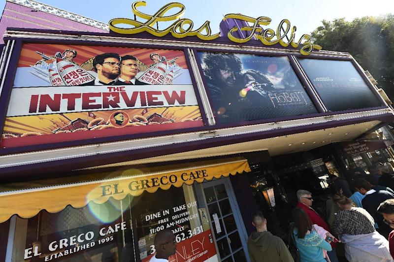 "Movie-goers wait in line outside the Los Feliz 3 Cinema in Los Angeles, California on December 25, 2014 to purchase tickets for the ""The Interview"" (AFP Photo/Robyn Beck)"