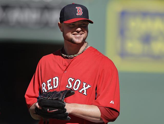 Boston Red Sox pitcher Jon Lester smiles during a baseball team workout on Tuesday, Oct. 1, 2013, at Fenway Park in Boston. The Red Sox host Game 1 of the AL divisional series on Friday, Oct. 4, against the winner of Wednesday's wild-card playoff game between the Cleveland Indians and Tampa Ray Rays. (AP Photo/Steven Senne)