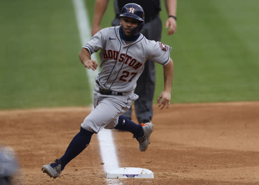 Houston Astros' Jose Altuve rounds third bse to score on a single hit by Yuli Gurriel off Colorado Rockies starting pitcher German Marquez in the fifth inning of a baseball game Thursday, Aug. 20, 2020, in Denver. (AP Photo/David Zalubowski)