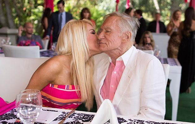 Hef and Crystal share a kiss. Source: Getty