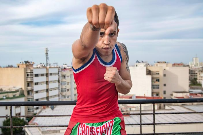 Moroccan Muay Thai boxer Zakaria Bouamama trains on a roof in Rabat on Wednesday ...
