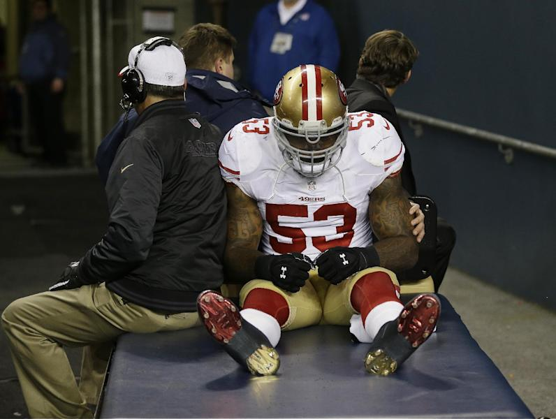 San Francisco 49ers' NaVorro Bowman is taken to the locker room on a cart after injuring his leg during the second half of the NFL football NFC Championship game against the Seattle Seahawks, Sunday, Jan. 19, 2014, in Seattle. (AP Photo/Marcio Jose Sanchez)