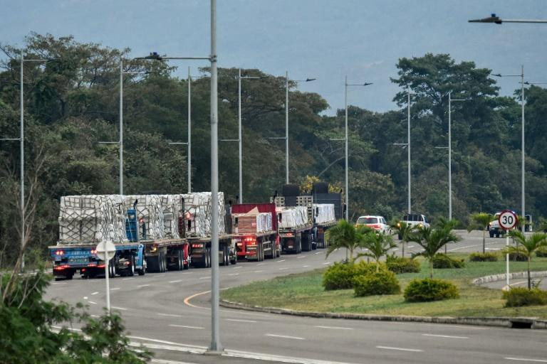 Trucks loaded with humanitarian aid for Venezuela drive towards the Tienditas Bridge in Cucuta, Colombia, where aid from Washington has piled up on the border with Venezuela, unable to enter