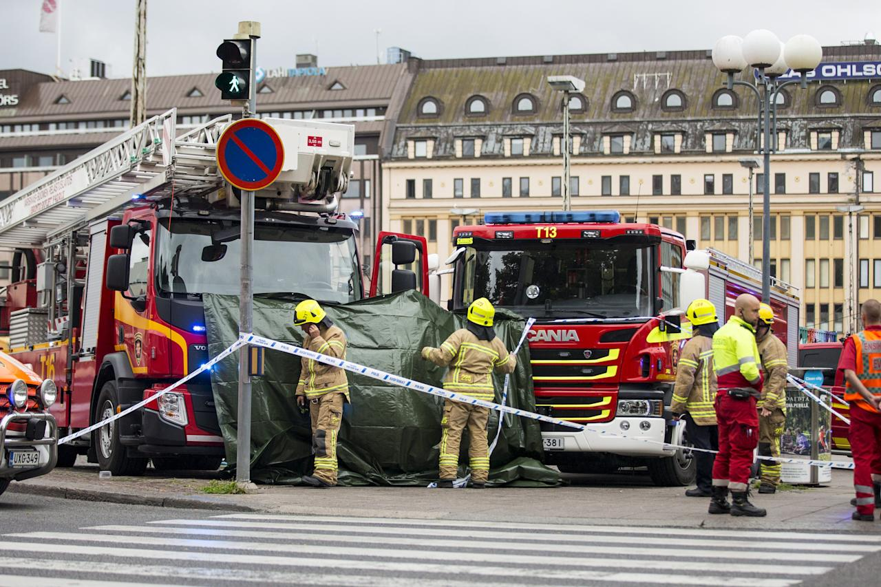 <p>Rescue personnel have cordoned off the area at the Turku Market Square in the Finnish city of Turku where several people were stabbed on Aug. 18, 2017. (Roni Lehti/AFP/Getty Images) </p>