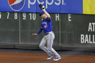 Toronto Blue Jays right fielder Derek Fisher misses the catch on a ball hit by New York Yankees' Clint Frazier during the second inning of a baseball game on Tuesday, Sept. 15, 2020, in New York. Fisher was charged with an error. (AP Photo/Adam Hunger)