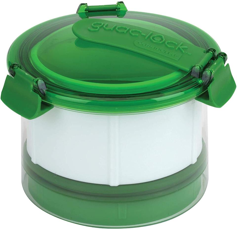 """Becauseif you happen to have any guacamole left over (a rare occurrence) this can keep it fresh until you're ready to eat the rest of it ... probably like 10 minutes later.This is top-rack dishwasher-safe. It can fit 12-24 ounces of guacamole or other dips.<br /><br /><strong>Get it from Amazon for <a href=""""https://www.amazon.com/Casabella-Guac-Lock-Container-Green-White/dp/B00ZCYU6IK?&linkCode=ll1&tag=huffpost-bfsyndication-20&linkId=2e3b71b2aac4656df66352c6c669e57e&language=en_US&ref_=as_li_ss_tl"""" target=""""_blank"""" rel=""""noopener noreferrer"""">$18.86</a>.</strong>"""