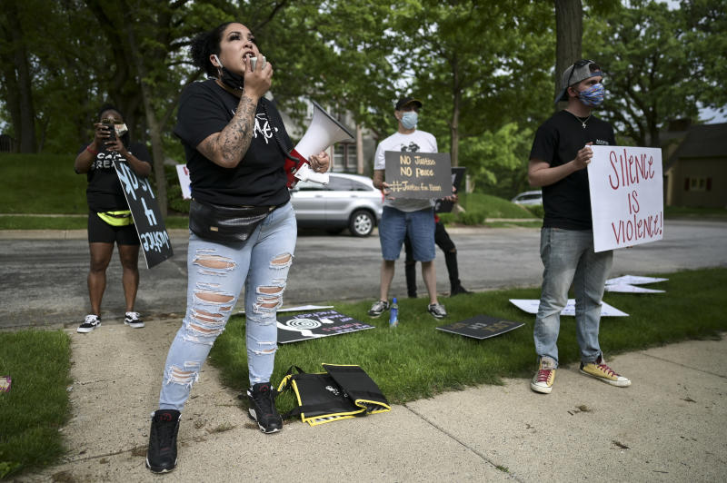 Ashley Quinones, widow of Brian Quinones, who was killed by Edina and Richfield police in 2019, protest outside Hennepin County Attorney Mike Freeman's home in Minneapolis, Minn. Wednesday, May 27, 2020.  Mayor Jacob Frey on Wednesday called for an arrest and charges against the now-fired Minneapolis police officer Derek Chauvin who knelt on the neck of George Floyd as he pleaded to breathe shortly before his death, in an incident caught on video that drew international outrage. Frey said he is calling upon Freeman to seek charges involved with the Monday incident. (Aaron Lavinsky/Star Tribune via AP)