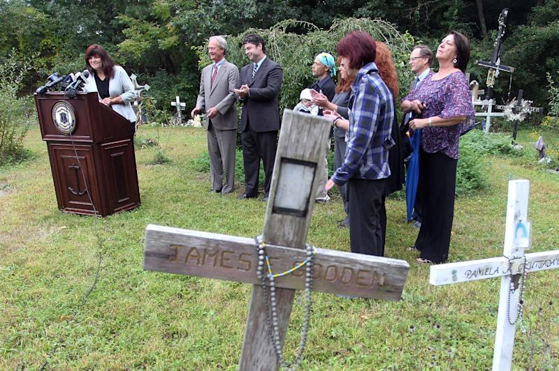Gina Russo, left, board president of the Station Fire Memorial Foundation, speaks with the media during a press conference at the site of the nightclub fire in West Warwick, R.I., Friday, Sept. 28, 2012. Ray Villanova, not pictured, the owner of the site of a 2003 nightclub fire that killed 100 people, is donating the land for a permanent memorial, bringing an end to a years-long effort to secure the site of The Station fire by families of those killed and survivors of the blaze. (AP Photo/Stew Milne)