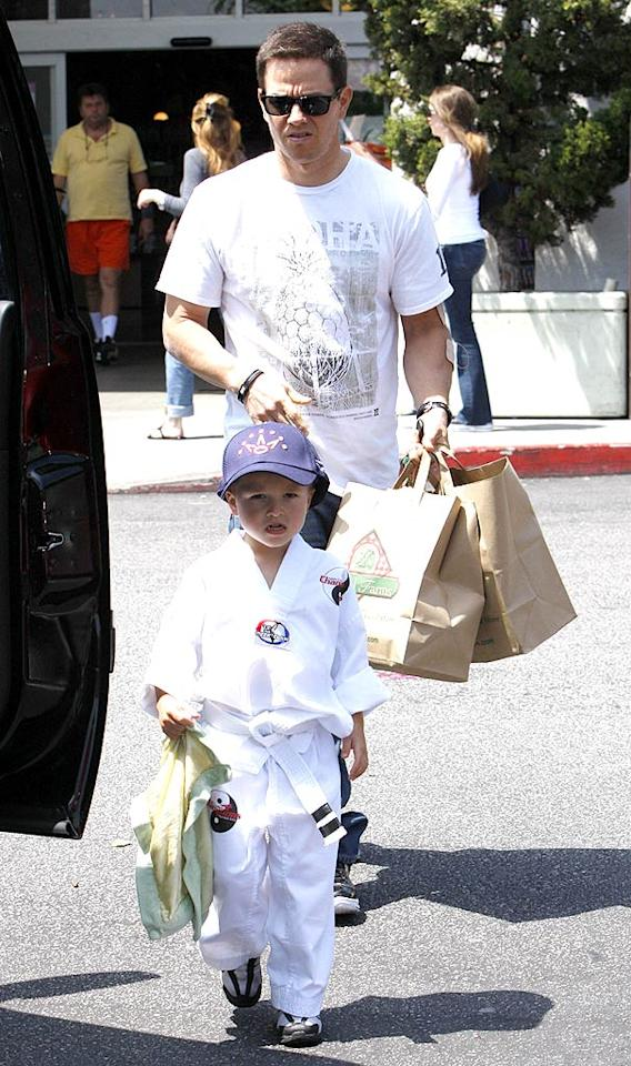 """Meanwhile, """"Date Night's"""" Mark Wahlberg took his son along for an outing to the same upscale grocery store chain. The tyke made a perfect mini bodyguard for his dad in his karate ensemble. <a href=""""http://www.infdaily.com"""" target=""""new"""">INFDaily.com</a> - April 24, 2010"""