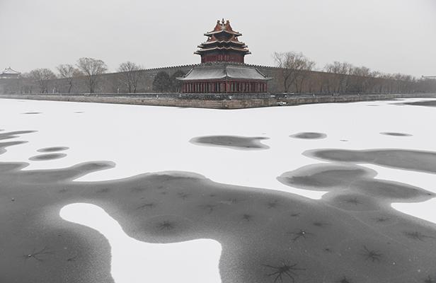 Snow is seen in the moat surrounding the Forbidden City during a snowfall in Beijing on February 21, 2017.