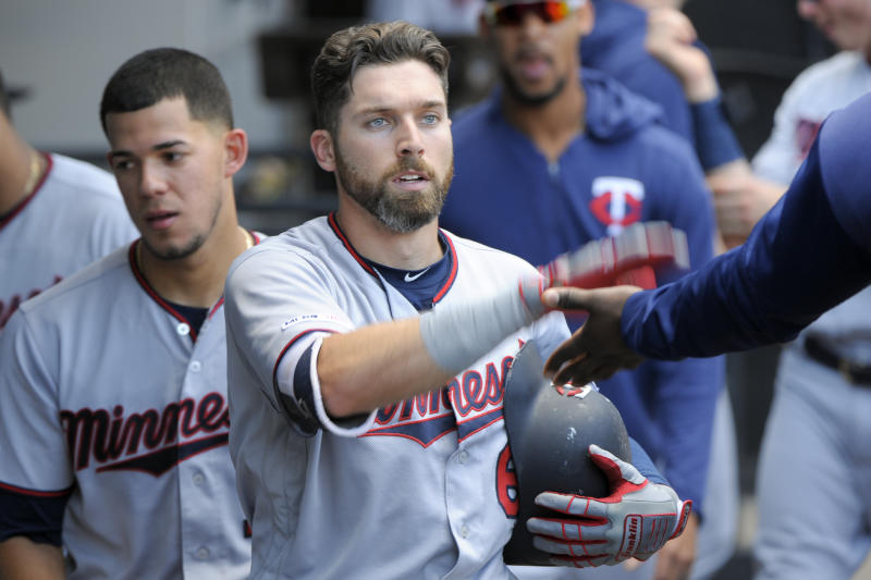 Minnesota Twins' Jake Cave (60) celebrates his seventh-inning home run against the Chicago White Sox during a baseball game Thursday, Aug. 29, 2019, in Chicago. (AP Photo/Mark Black)