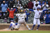 Pittsburgh Pirates catcher Michael Perez (5) looks on as Chicago Cubs' Jason Heyward (22) scores during the seventh inning of a baseball game, Saturday, May 8, 2021, in Chicago. (AP Photo/Matt Marton)