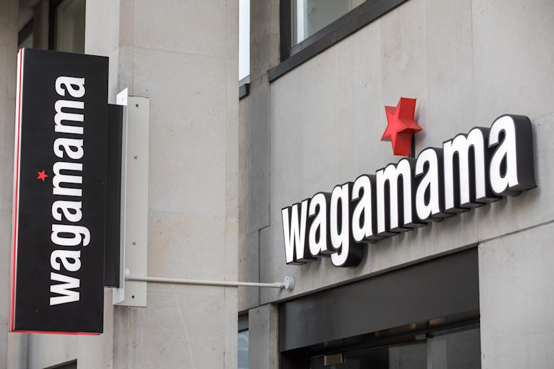 A sign sits above a Wagamama Ltd. restaurant in London, U.K. Photo: Jason Alden/Bloomberg