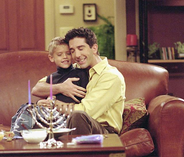 """Cole Sprouse and David Schwimmer star in <em>Friends</em> episode """"The One with the Holiday Armadillo,"""" which premiered on Dec. 14, 2000. (Photo: NBCU Photo Bank)"""