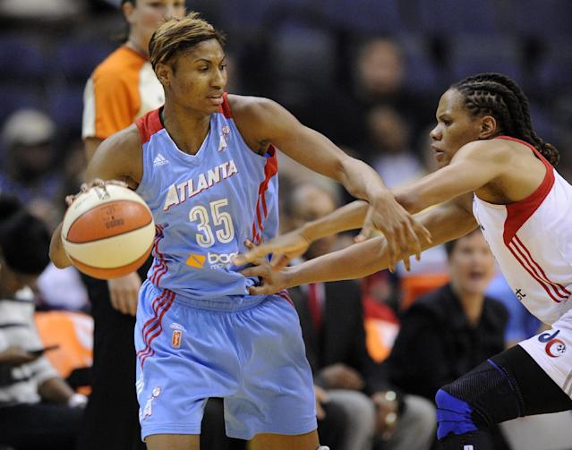 Atlanta Dream guard Angel McCoughtry (35) tries to get past Washington Mystics forward Monique Currie, right, during the first half of Game 2 of the WNBA basketball Eastern Conference semifinal series, Saturday, Sept. 21, 2013, in Washington. (AP Photo/Nick Wass)