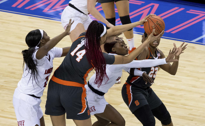 Syracuse's Kamilla Cardoso (14) attempts to pass the ball to teammate Kiara Lewis (23) as Syracuse's Amaya Finklea-Guity, left, and Taleah Washington, second from right, defend during the first half of an NCAA college basketball game in the semifinals of Atlantic Coast Conference tournament in Greensboro, N.C., Saturday, March 6, 2021. (AP Photo/Ben McKeown)